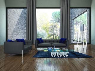 Salon contemporain Blazer. On aime les dossiers capitonnés et les passepoils bleu turquoise.
